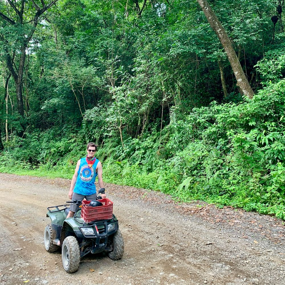 Charles Alexander Kosydar riding an ATV while traveling in Costa Rica
