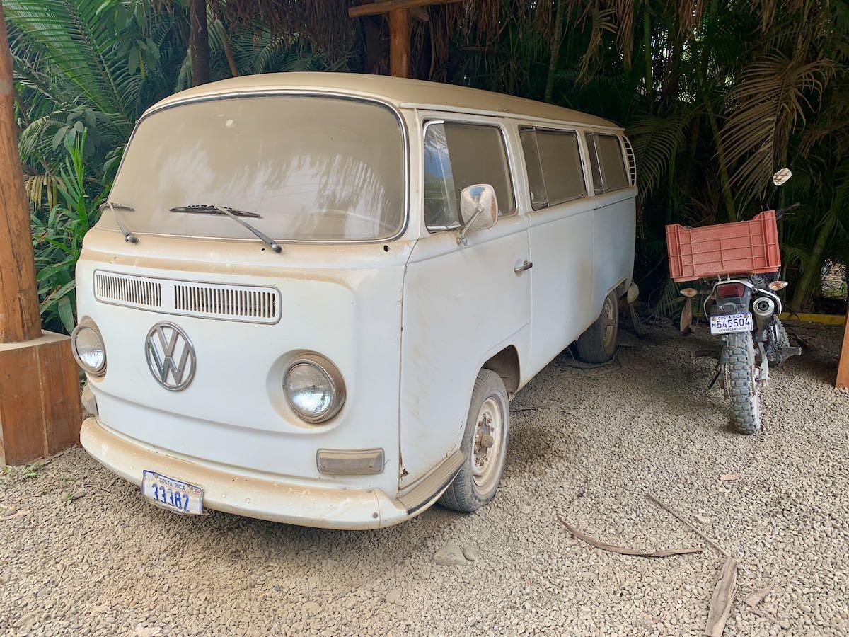 Volkswagen van covered in dust in Playa Guiones Costa Rica