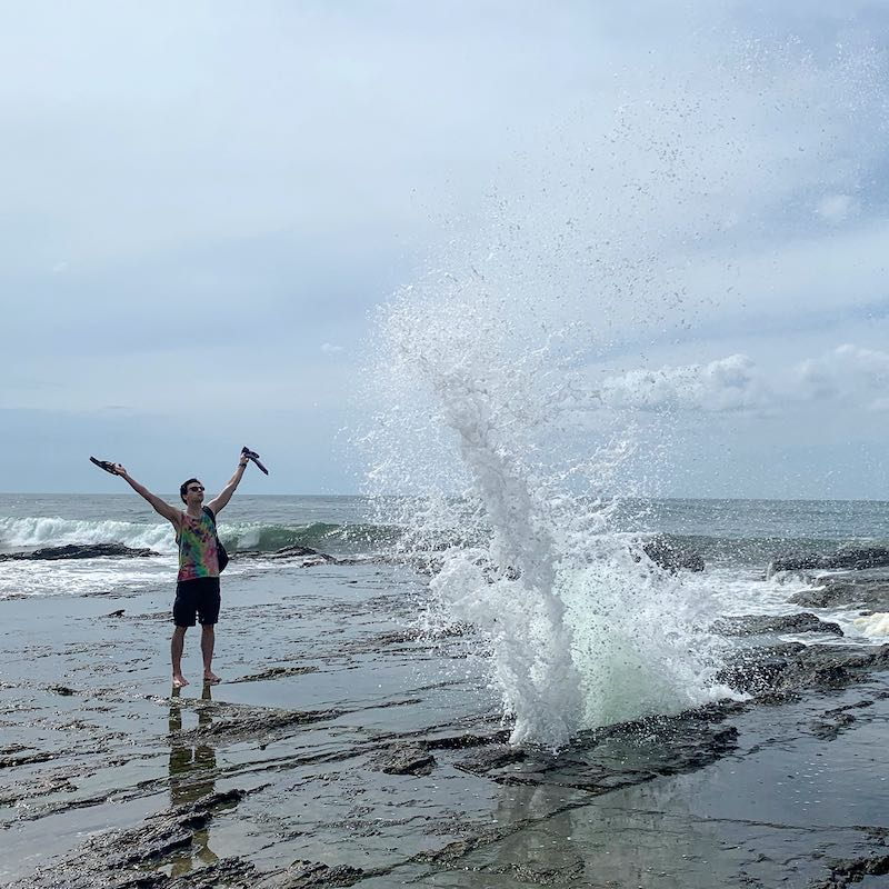 Charles Kosydar standing next to a blowhole in Costa Rica