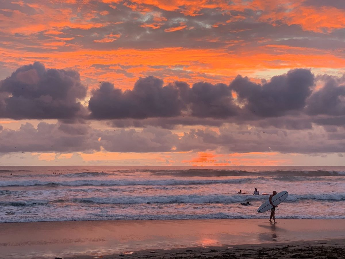 Surfers at sunset on Playa Guiones in Costa Rica