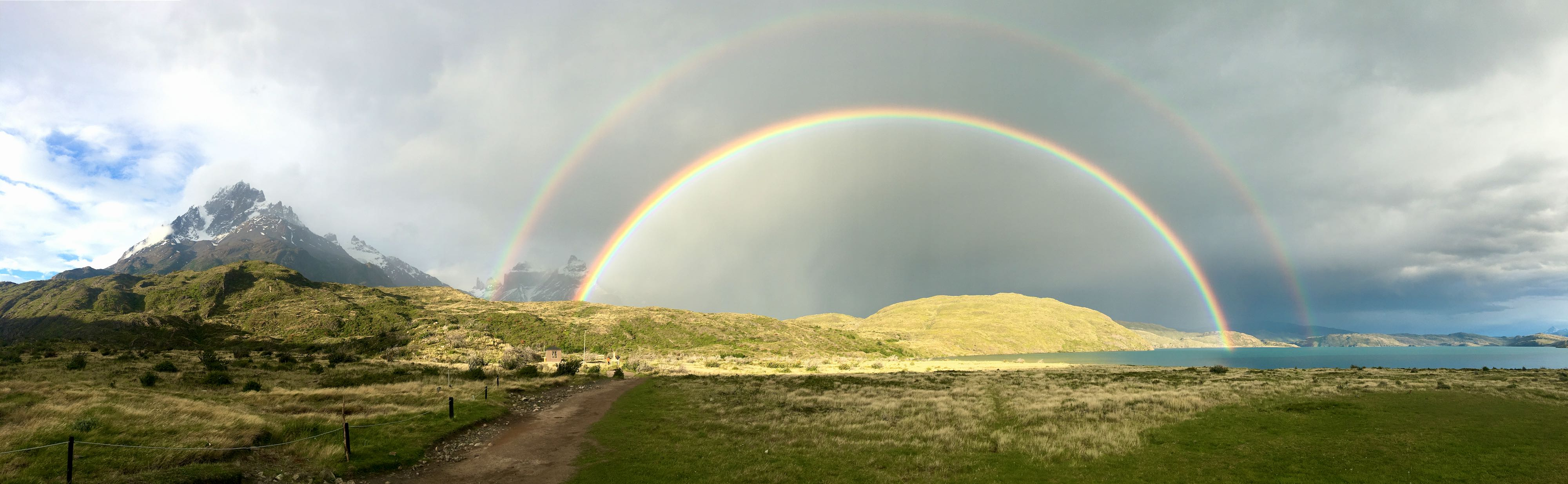 A double rainbow over the mountains while hiking in Patagonia