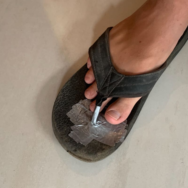 A flip flop with duct tape